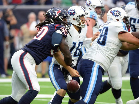 Houston Texans outside linebacker Jadeveon Clowney (90) steps the ball from Tennessee Titans quarterback Matt Cassel (16) during gate second half of an NFL football game Sunday, Oct. 1, 2017, in Houston. Houston recovered the ball. (AP Photo/George Bridges)