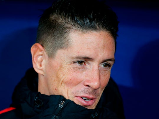 FILE - In this Nov. 18, 2017 file photo, Atletico Madrid's Fernando Torres sits on the substitutes bench before a Spanish La Liga soccer match between Atletico Madrid and Real Madrid at the Metropolitano stadium in Madrid, Spain.  Striker Torres said on Monday April 9, 2018, that he will leave Atletico Madrid at the end of this season, to make way for others at the club.(AP Photo/Paul White, File)