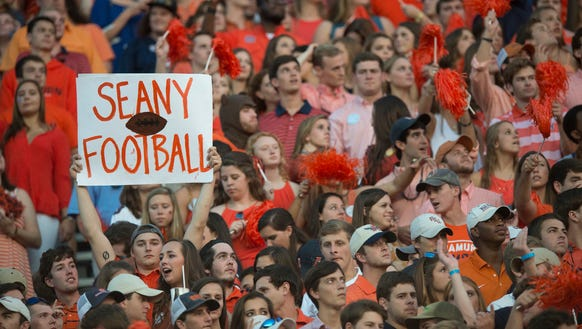 A fan holds up a sign for Auburn quarterback Sean White