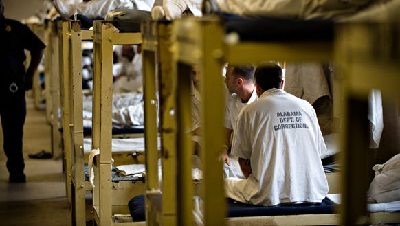 Inmates sit on their bunks at Draper Correction Facility