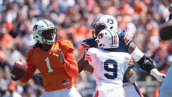 Auburn quarterback Woody Barrett (1) looks to throw