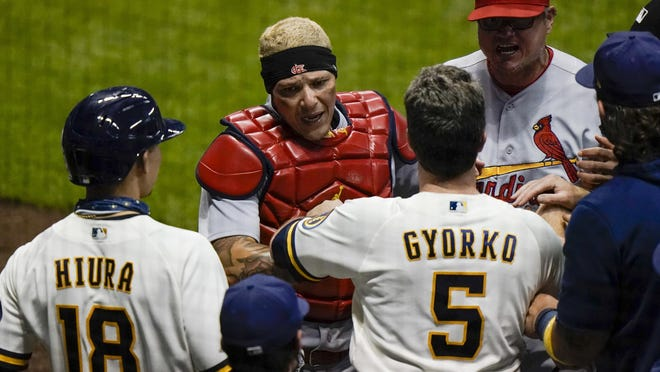 St. Louis Cardinals catcher Yadier Molina has words with Milwaukee Brewers' Keston Hiura and Jedd Gyorko during the fifth inning of a game on Tuesday, Sept. 15, in Milwaukee.