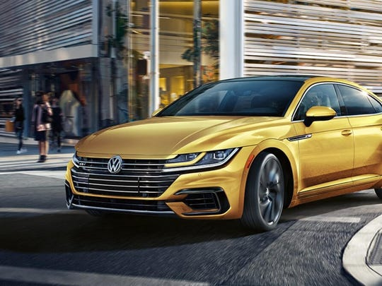 The Arteon's wide stance and fastback profile is accented by sharp creases.