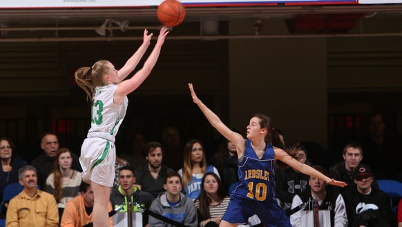 From left, Irvington's Lindsay Halpin (13) puts up a shot in front of Ardsley's Danielle Scaperrotta (10) during the Section 1 Class B championship game at the Westchester County Center in White Plains Feb. 28, 2015. Irvington won the game 50-48.