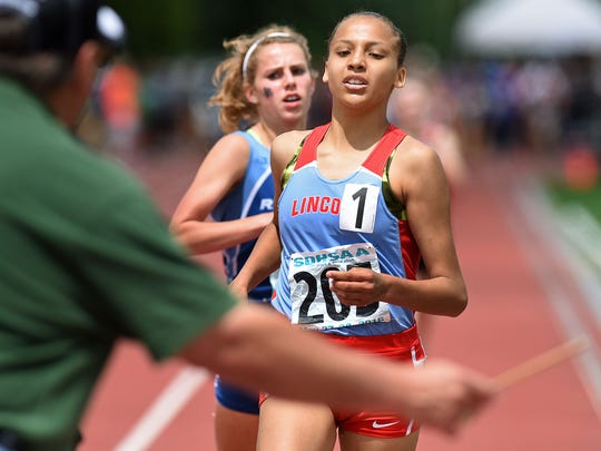 Lincoln's Jasmyne Cooper approaches the finish line to win the AA girls 1600-meter run during the 2016 state meet.
