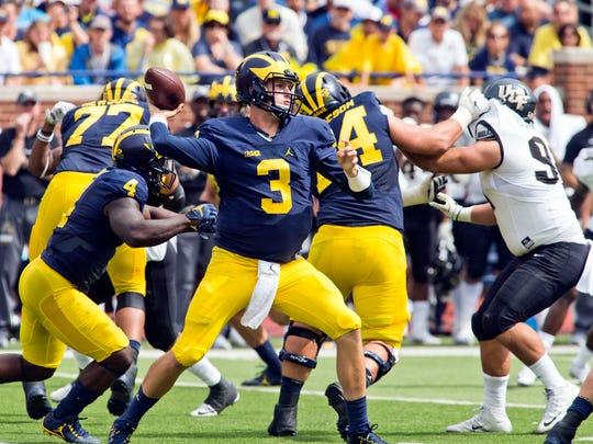 Michigan Wolverines quarterback Wilton Speight throws