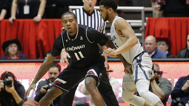 Cincinnati Bearcats forward Gary Clark (11) and Xavier guard Trevon Bluiett (5) will clash in another Crosstown Shootout this year. UC is No. 13 and XU is No. 17 in the USA Today preseason coaches poll.