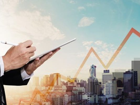 businessman-working-digital-tablet-with-panorama-city-and-raising-arrow_large.jpg