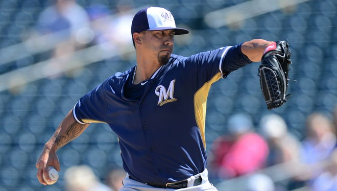 Milwaukee Brewers starting pitcher Kyle Lohse (26) pitches against the Texas Rangers at Surprise Stadium.