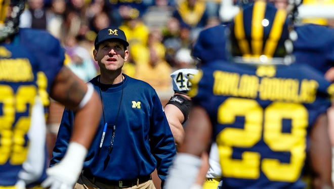 About 60,000 fans showed up at Michigan Stadium on Saturday for the spring game, mostly because of new Wolverines head coach Jim Harbaugh.
