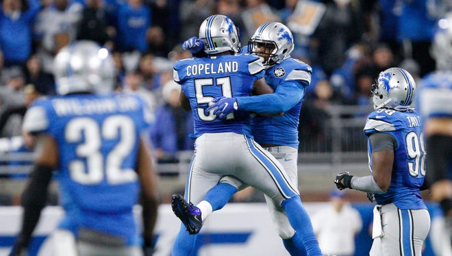 Detroit Lions defensive end Kerry Hyder celebrates with linebacker Brandon Copeland (51) during the fourth quarter against the Chicago Bears on Dec 11, 2016, at Ford Field.