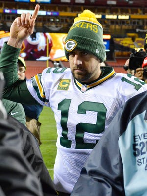 Quarterback Aaron Rodgers celebrates after the Packers beat the Redskins 35-18 in an NFC wild-card game Sunday in Landover, Md.