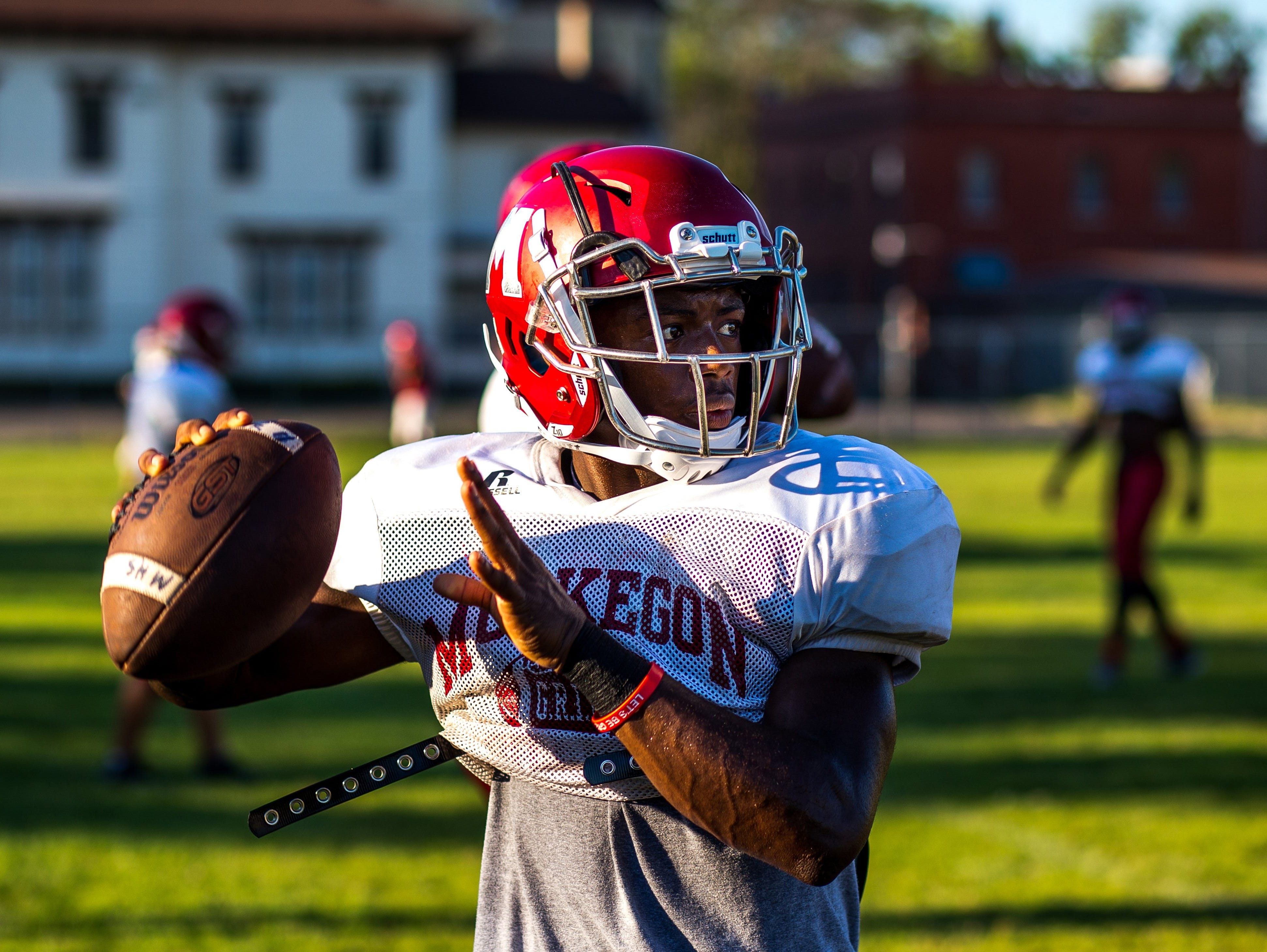 Muskegon senior quarterback Kalil Pimpleton practices Tuesday, Aug. 16, 2016, in Muskegon, Mich.