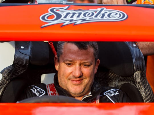 Former NASCAR driver Tony Stewart readies his sprint car prior to racing in the 69th Pay Less Little 500 presented by UAW GM at Anderson Speedway.