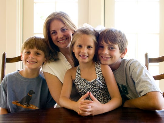 Allison Dooley with children, from left, Peyton, Julianna