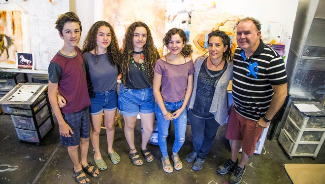 The Milan family poses inside the Milan Art Institute ,Thursday, April 19, 2018. From left to right are; Dino, 12, Dalia, 14, Dafni, 16, Dimitra, 18, Elli and John.