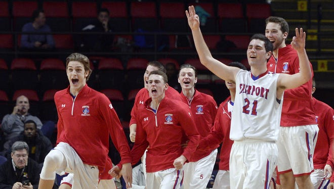 The Fairport bench celebrates after scoring at the buzzer to end the first half during thestate boys basketball Class AA semifinal in Binghamton, N.Y. on Saturday, March 18, 2017.