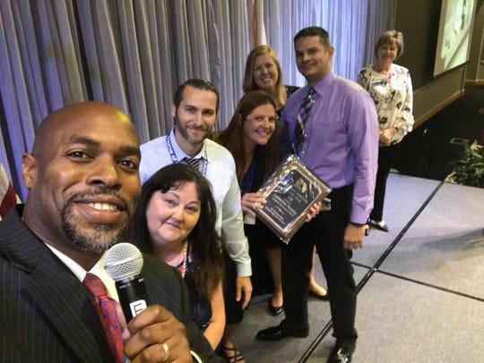 Departing Superintendent Desmond Blackburn awards Assistant