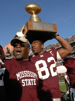 Former Mississippi State head football coach Sylvester Croom, seen here with tight end  Jason Husband celebrating State's 2007 Egg Bowl win over Ole Miss, will speak to the Jackson Touchdown Club on Monday night.