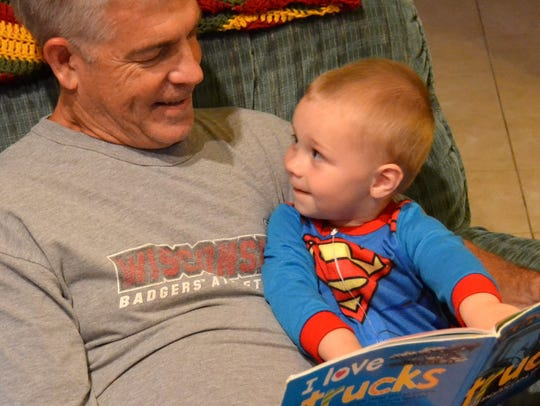 Brian Thoma reading to grandson.jpg