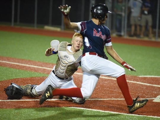 Mountain Home catcher Cody Lance tags a baserunner