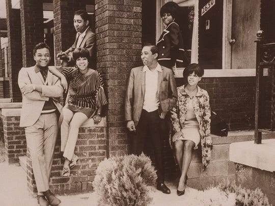 Motown's legendary songwriting team of Holland-Dozier-Holland at Hitsville, U.S.A., with the Supremes. From left, Lamont Dozier, Eddie Holland (with the guitar) and Brian Holland.
