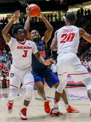 UTEP's Dominic Artis drives to the hoop guarded by