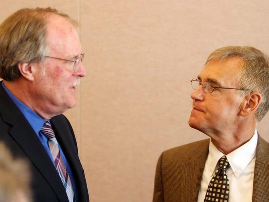 Bill Moller (left) and Jim Goetz talk after Cincinnnati