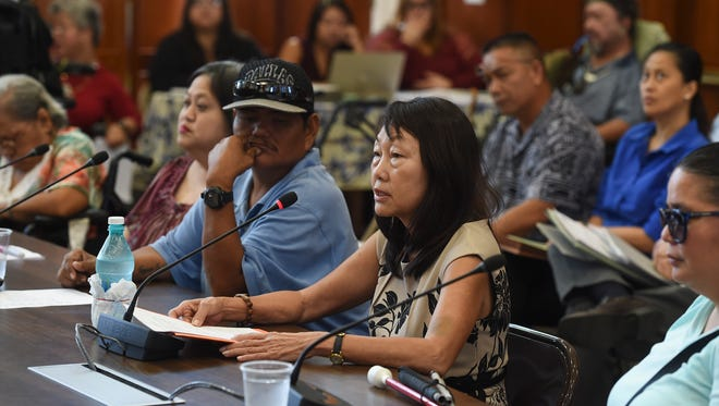 Lourdes Mesa, whose son Clinton, 30, is an individual with a disability and Guam Regional Transit Authority Paratransit Service rider, discusses her concerns during a GRTA oversight hearing at the Guam Congress Building on Nov. 8, 2017.