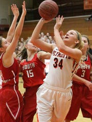 Plymouth's Gwen Streblow (34) aims for the basket against