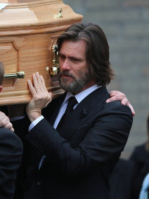 Jim Carrey carries coffin of his ex-girlfriend Cathriona White in Ireland, Oct. 10, 2015.