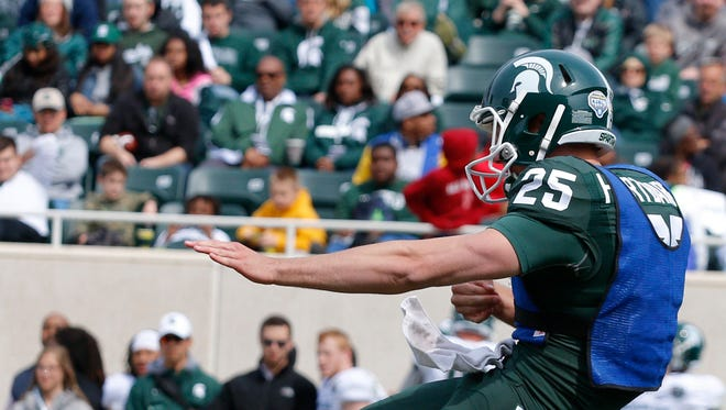 Michigan State punter Jake Hartbarger in the Green and White Game last spring.