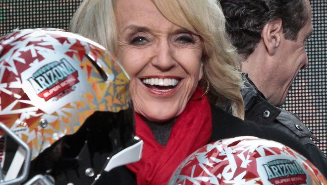 Arizona Gov. Jan Brewer at a New York ceremony to pass official hosting duties of Super Bowl 2015 to Arizona on Feb. 1, 2014.