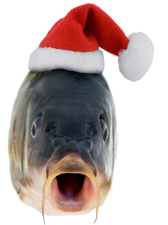 Christmas fish in Santa red hat