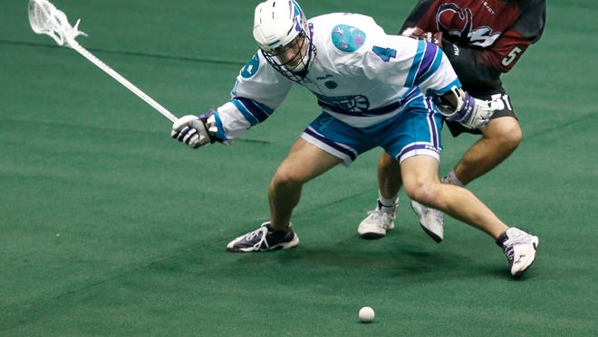 Knighthawks' Graeme Hossack and Colorado Mammoth's Eli McLaughlin  in the second quarter at the Blue Cross Arena at the War Memorial.
