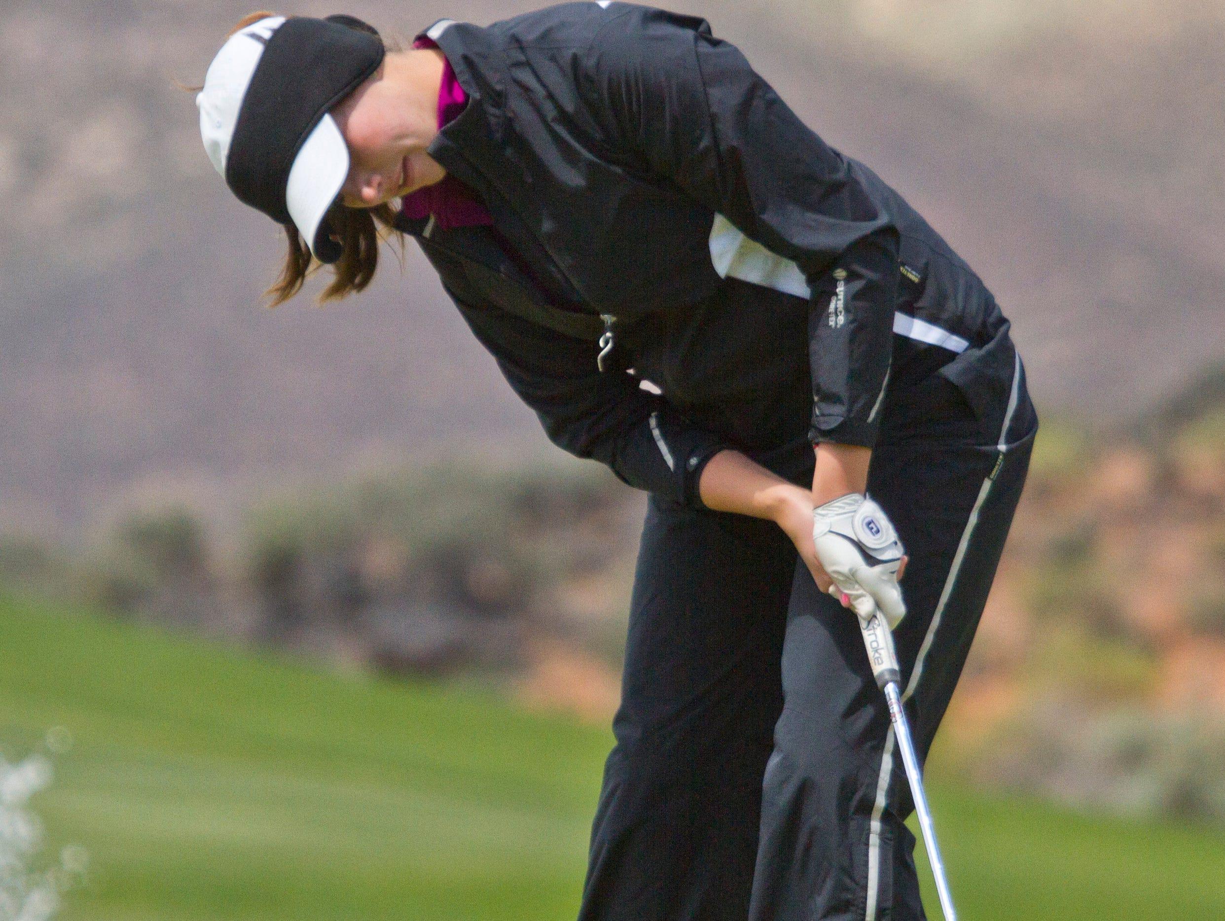 Desert Hills golfer Katie Perkins goes for a long putt Thursday at Sky Mountain.
