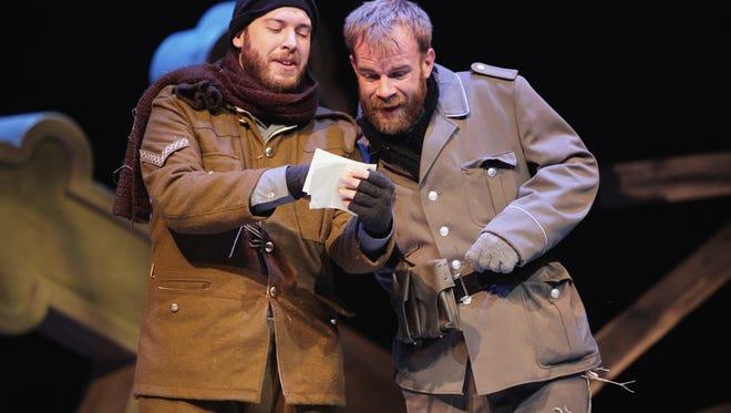 "Aaron Epstein, left, plays British Cpl. Tug Wilson and Jeffrey K. Miller plays his German counterpart, Sgt. Gerhardt Dietrich in ""Soldier's Christmas."""