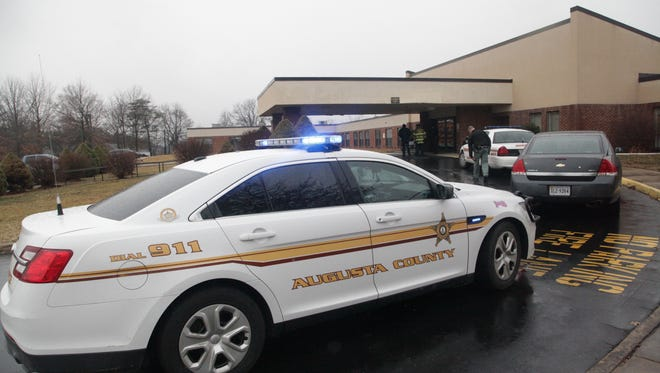 Police secure the crime scene at Shenandoah Nursing Home in Fishersville where a man reportedly shot a patient and then himself on Saturday morning.