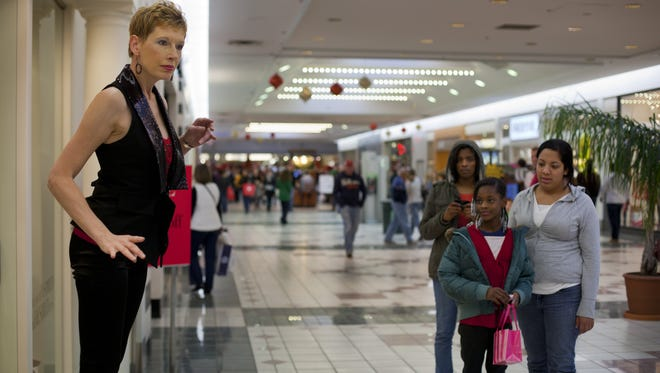 Mannequin model Carrie Schreiner of Greece entertained and puzzled shoppers outside Cache  at Eastview Mall on Nov. 26, 2010.