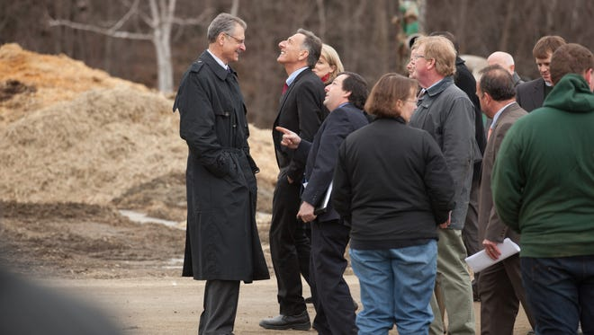 Gov. Shumlin looks up at new AT&T cellular equipment on the side of a silo at a family farm in Richmond before press conference Thursday.