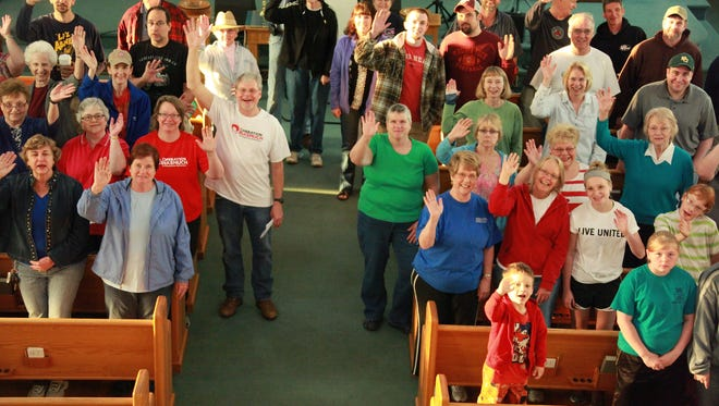 Over 80 volunteers gather at Laurel Hill Baptist Church in Verona Saturday for a day of good works called Operation Inasmuch. Breaking into teams, they performed projects for people in need throughout Augusta County.