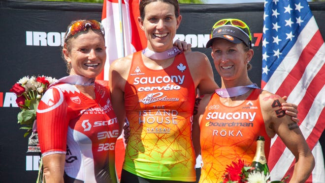 The top three female finishers of the St. George Ironman Saturday, May 2, 2015.