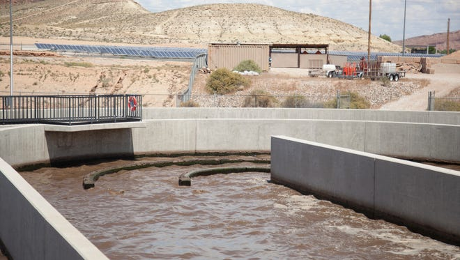 City employees at the St. George Sewage Treatment Plant explain the various functions of the plant to local residents during a Water Week tour Wednesday, May 6, 2015.