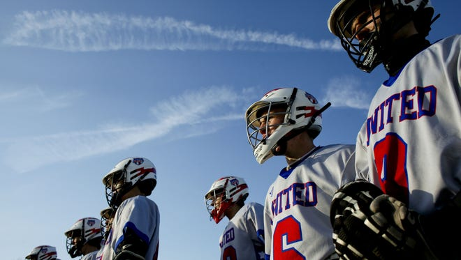 Port Huron United players watch from the sidelines during a lacrosse game May 6, 2014 at Central Middle School in Port Huron.