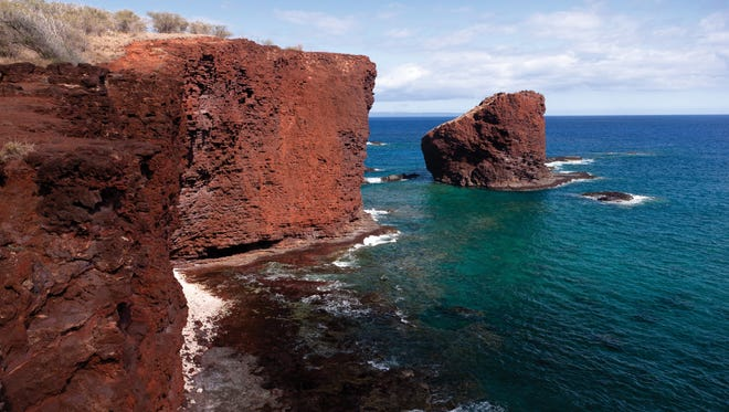 Lanai/Pu'u Pehe (Sweetheart Rock):  Sweetheart Rock commands you to think of love. Legend tells of a warrior in love with a Maui woman who hid her at a sea cave at the cliff's base. When she drowned in a storm, he climbed this 80-foot outcrop then jumped into the surf, where many visitors now snorkel and dive.
