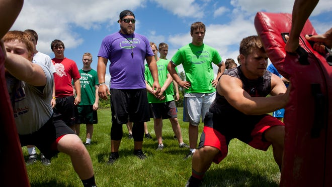 Tim Lelito watches as he runs drills with a group during Lelito's Legacy Camp Tuesday, June 23, 2015 at St. Clair High School.