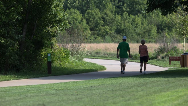Walkers took a stroll along the Louisville Loop as they visited The Park Lands of Floyds Fork.July 15, 2015