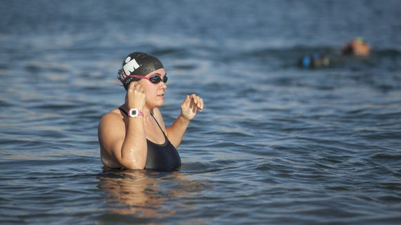 Spectrum Audience Analyst Casie Forbes trains with a local triathlon group at Sand Hollow Reservoir in preparation for the St. George Ironman Thursday, July 16, 2015.