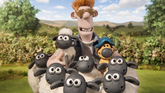 "Shaun and his sheep friends pose with the farmer and Bitzer the dog in ""Shaun the Sheep Movie."""