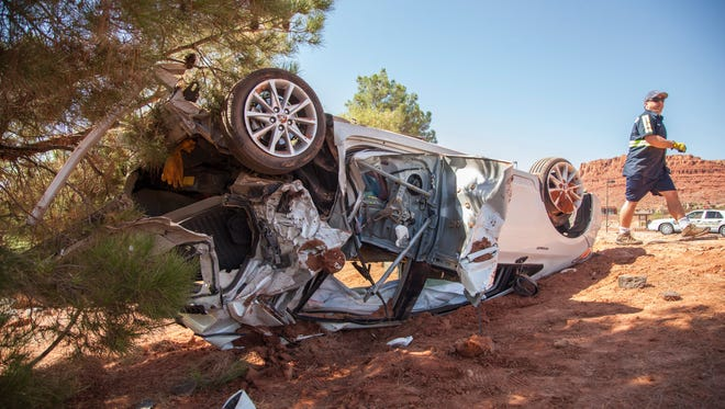 St. George Police and St. George Fire respond to a 2-vehicle collision on Snow Canyon Parkway Saturday, Aug. 8, 2015. Officers on scene describe the incident, stating the yellow truck rear-ended the white sedan at a high rate of speed.